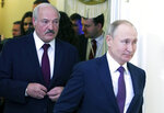 FILE - In this Friday, Dec. 20, 2019 file photo, Russian President Vladimir Putin, right, and Belarusian President Alexander Lukashenko walk before a meeting of the Supreme Eurasian Economic Council in St. Petersburg, Russia. Lukashenko said Friday, June 19, 2020 that his government has thwarted plans to destabilize Belarus ahead of a presidential vote in August, a statement that follows the detention of his top challenger, Viktor Babariko, the former head of Russia-owned Belgazprombank. (Mikhail Klimentyev, Sputnik, Kremlin Pool Photo via AP, File)