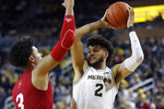Michigan forward Isaiah Livers (2) is defended by Indiana forward Justin Smith (3) during the second half of an NCAA college basketball game Sunday, Feb. 16, 2020, in Ann Arbor, Mich. (AP Photo/Carlos Osorio)