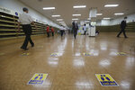 Social distancing signs are seen on the floor for a service to help stop the spread of new coronavirus at the Yoido Full Gospel Church in Seoul, South Korea, Sunday, July 5, 2020. The signs read:
