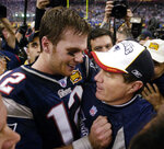 FILE - This Feb. 1, 2004 file photo shows New England Patriots quarterback Tom Brady and head coach Bill Belichick embracing after defeating the Carolina Panthers 32-29 in Super Bowl XXXVIII in Houston. Belichick became Patriots head coach in 2000 and drafted a skinny quarterback from Michigan with the 199th pick. The following season, the pair begin their run as the greatest quarterback-coach duo in NFL history by winning the first of their half dozen Super Bowls together. (AP Photo/David J. Phillip, File)
