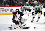 Colorado Avalanche goaltender Philipp Grubauer, front, stops a shot as Dallas Stars center Joe Pavelski drives to the crease in the second period of an NHL hockey game Tuesday, Jan. 14, 2020, in Denver. (AP Photo/David Zalubowski)