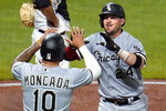 Chicago White Sox's Yasmani Grandal (24) celebrates with Yoan Moncada as he heads to the dugout after hitting a two-run home run off Pittsburgh Pirates relief pitcher Dovydas Neverauskas during the fifth inning of a baseball game in Pittsburgh, Tuesday, Sept. 8, 2020. (AP Photo/Gene J. Puskar)
