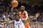 Duke's Zion Williamson (1) and Syracuse's Paschal Chukwu (13) struggle for possession during overtime in an NCAA college basketball game in Durham, N.C., Monday, Jan. 14, 2019. Syracuse won 95-91. (AP Photo/Gerry Broome)