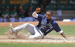 Seattle Mariners' Tim Beckham slides to score against the Oakland Athletics in the second inning of a baseball game Wednesday, July 17, 2019, in Oakland, Calif. (AP Photo/Ben Margot)