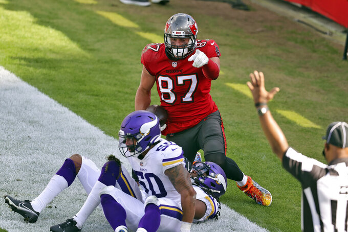 Tampa Bay Buccaneers tight end Rob Gronkowski (87) celebrates after scoring against the Minnesota Vikings during the second half of an NFL football game Sunday, Dec. 13, 2020, in Tampa, Fla. (AP Photo/Mark LoMoglio)