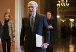 Senate Majority Leader Mitch McConnell, R-Ky., walks to the chamber as the Republican-led Senate is set to deal President Donald Trump a rebuke on his declaration of a national emergency at the Mexican border, with the only remaining question how many GOP senators will join Democrats in defying him, at the Capitol in Washington, Thursday, March 14, 2019. (AP Photo/J. Scott Applewhite)