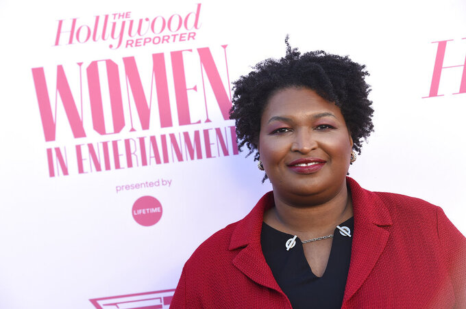 """FILE - Stacey Abrams arrives at The Hollywood Reporter's Women in Entertainment Breakfast Gala in Los Angeles on Dec. 11, 2019. Berkley announced Tuesday that it had acquired rights to three out-of-print novels by Abrams that she had written nearly 20 years ago under the name Selena Montgomery. Berkley, a Penguin Random House imprint, will begin reissuing the books; """"Rules of Engagement,"""" """"The Art of Desire"""" and """"Power of Persuasion,"""" in 2022. (Photo by Jordan Strauss/Invision/AP, File)"""