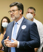 Tim Moore, president of the Mississippi Hospital Association, speaks during a press conference about the launch of the Yes on 76 campaign at the Mississippi Hospital Association in Madison, Miss., Tuesday, May 11, 2021. Doctors and health care advocates are seeking to get Medicaid expansion on the Nov. 2022 ballot. (Eric Shelton/The Clarion-Ledger via AP)