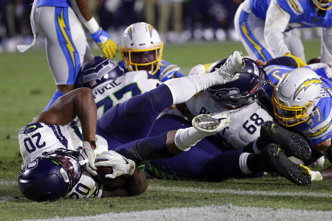 Seattle Seahawks running back Rashaad Penny scores against the Los Angeles Chargers during the first half of an NFL preseason football game Saturday, Aug. 24, 2019, in Carson, Calif. (AP Photo/Gregory Bull)