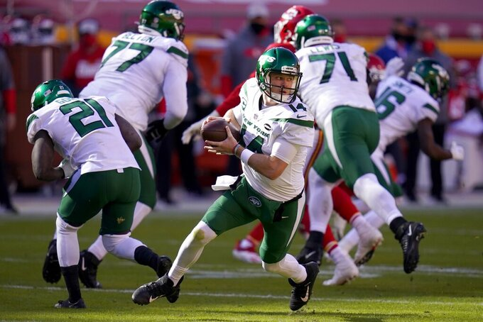 New York Jets quarterback Sam Darnold (14) rolls out of the pocket in the second half of an NFL football game against the Kansas City Chiefs on Sunday, Nov. 1, 2020, in Kansas City, Mo. (AP Photo/Jeff Roberson)