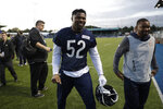 Chicago Bears' outside linebacker Khalil Mack, 52, walks off the field after an NFL training session at the Allianz Park stadium in London, Friday, Oct. 4, 2019. The Chicago Bears are preparing for an NFL regular season game against the Oakland Raiders in London on Sunday. (AP Photo/Matt Dunham)