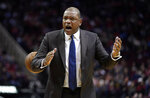 LA Clippers coach Doc Rivers yells at his players during the first half of an NBA basketball game against the Houston Rockets Wednesday, Nov. 13, 2019, in Houston. (AP Photo/David J. Phillip)