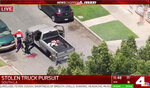 This May 22, 2020, photo from video provided by KNBC-TV shows the end of a pursuit a pickup that had been reported stolen after being pursued by police on Southern California streets and freeways. Two people were taken into custody. The coronavirus hasn't been kind to car owners. With more people than ever staying home to lessen the spread of COVID-19, their sedans, pickup trucks and SUVs are parked unattended on the streets, making them easy targets for opportunistic thieves. Sometimes they're even stolen in broad daylight and lead to high-speed police pursuits. (KNBC-TV via AP)