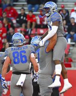 Memphis wide receiver Antonio Gibson, right, celebrates his touchdown with offensive lineman Manuel Orona-Lopez as tight end Joey Magnifico watches during the second half of an NCAA college football game against Houston, Saturday, Nov. 16, 2019, in Houston. (AP Photo/Eric Christian Smith)