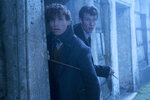 This image released by Warner Bros. Pictures shows Eddie Redmayne, left and Callum Turner in a scene from