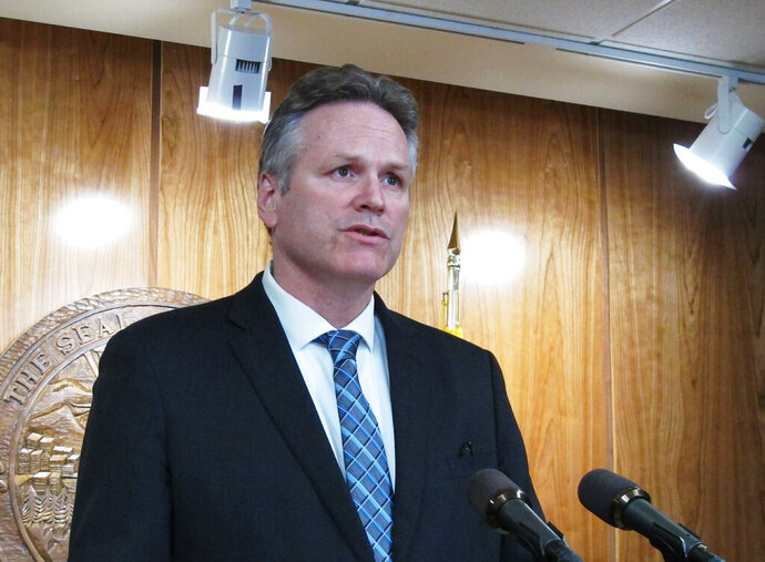 Alaska Gov. Mike Dunleavy addresses reporters in Juneau, Alaska, Wednesday, May 15, 2019, the constitutional deadline for the end of the regular session. Dunleavy said he intended to call lawmakers into a special session. (AP Photo/Becky Bohrer)
