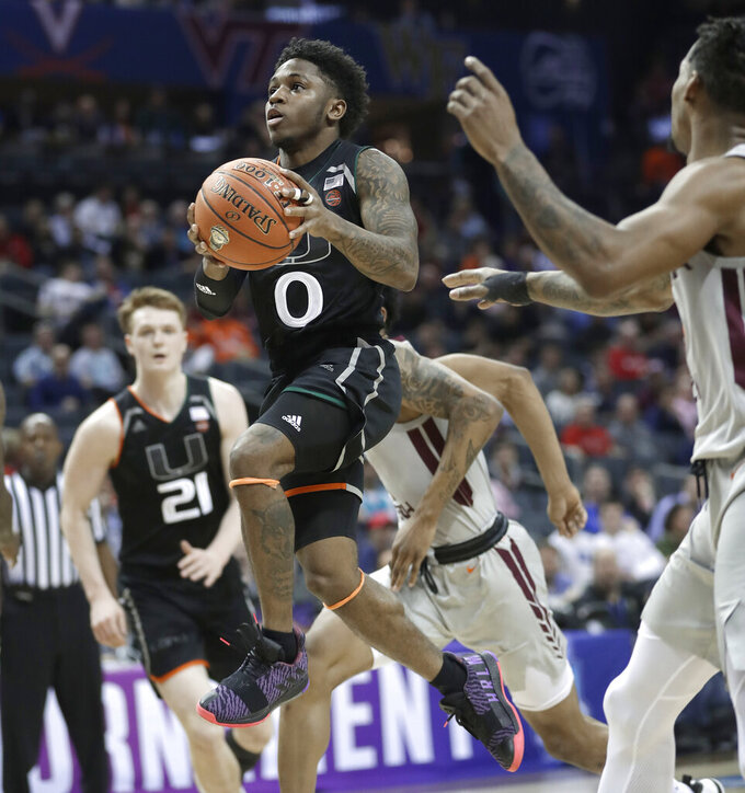 Miami's Chris Lykes (0) drives to the basket against Virginia Tech during the first half of an NCAA college basketball game in the Atlantic Coast Conference tournament in Charlotte, N.C., Wednesday, March 13, 2019. (AP Photo/Nell Redmond)