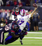 Buffalo Bills quarterback Josh Allen (17) tries to throw a pass as he is tackled by Houston Texans' Whitney Mercilus (59), A.J. Moore Jr., right, and Vernon Hargreaves III (28) during the second half of an NFL wild-card playoff football game Saturday, Jan. 4, 2020, in Houston. (AP Photo/Michael Wyke)