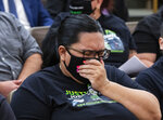 Sulay Lugo reacts as she attends a public fact-finding review for the fatal officer involved shooting of Jorge Gomez at the Clark County Government Center, on Friday, April 16, 2021, in Las Vegas. (Bizuayehu Tesfaye/Las Vegas Review-Journal via AP)