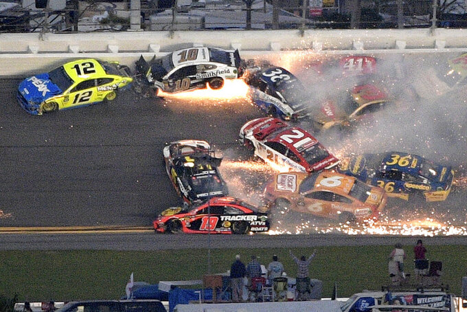 Ryan Blaney (12), Aric Almirola (10), Paul Menard (21), David Ragan (38) and Matt DiBenedetto (95) start a multi-car wreck between Turns 3 and 4 during the NASCAR Daytona 500 auto race at Daytona International Speedway Sunday, Feb. 17, 2019, in Daytona Beach, Fla. (AP Photo/Phelan M. Ebenhack)