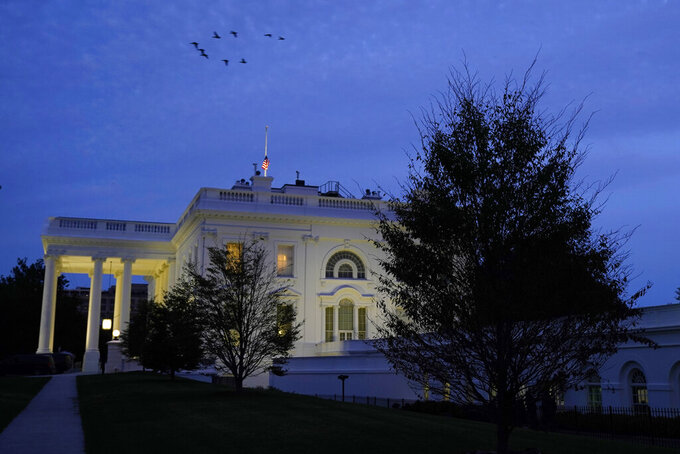 FILE - In this Oct. 4, 2020, file photo lights illuminate the White House in Washington. (AP Photo/Jacquelyn Martin, File)