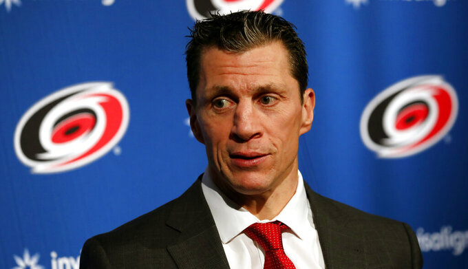 FILE - Carolina Hurricanes head coach Rod Brind 'Amour speaks at a press conference following an NHL hockey game against the Dallas Stars in Raleigh, N.C., in this Saturday, Feb. 16, 2019, file photo. The Carolina Hurricanes have reached a three-year contract extension with coach Rod Brind'Amour after three straight playoff appearances. The Hurricanes announced the agreement Thursday, June 17, 2021, a little more than a week after the Hurricanes were eliminated by reigning Stanley Cup champion Tampa Bay in the second round. (AP Photo/Karl B DeBlaker, File)