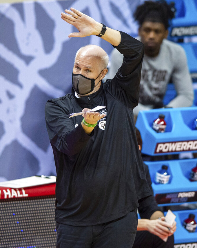 St. Bonaventure head coach Mark Schmidt signals to the players during the second half of a first round game against LSU in the NCAA men's college basketball tournament, Saturday, March 20, 2021, at Assembly Hall in Bloomington, Ind. (AP Photo/Doug McSchooler)