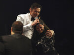Actor Hugh Jackman hugs Bronx teacher Melissa Salguero during the US dollars 1 million Global Teacher Prize in Dubai, United Arab Emirates, Sunday, March 24, 2019.  Kenyan educator Peter Tabichi, a science teacher who gives away 80 percent of his income to the poor in the remote Kenyan village of Pwani, won this year's prize. (AP Photo/Jon Gambrell)