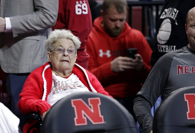 98-year-old Florence Dalby follows an NCAA college basketball game between Ohio State and Nebraska in Lincoln, Neb., Saturday, Jan. 26, 2019. Dalby is a University of Nebraska Lincoln graduate and has had a men's basketball season ticket for more than 80 years. Dalby loves Nebraska as much today as she did when she first started going to games in 1939. The Cornhuskers honored her during their Coaches Vs. Cancer game against Ohio State. (AP Photo/Nati Harnik)