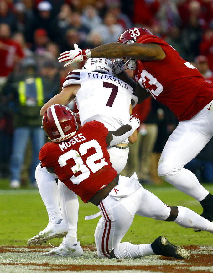 Mississippi State quarterback Nick Fitzgerald (7) is sacked by Alabama linebackers Dylan Moses (32) and Anfernee Jennings (33) during the second half of an NCAA college football game, Saturday, Nov. 10, 2018, in Tuscaloosa, Ala. (AP Photo/Butch Dill)