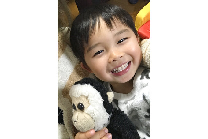 In this undated photo provided by Lucius Chiu, Alaric Chiu holds a stuffed toy in Tokyo. Alaric was 5 years old in 2019 when he died during a kayaking trip. The Hawaii private school Mid-Pacific Institute that coordinated the spring break program and his family have a settled a lawsuit over the boy's drowning for $7.2 million. (Lucius Chiu via AP)