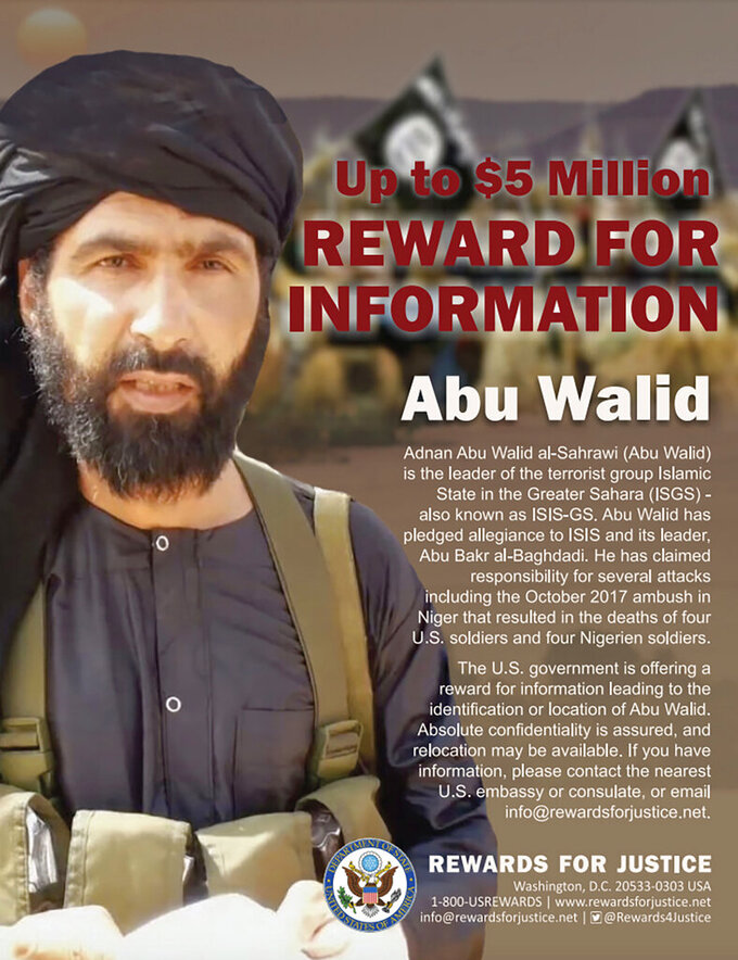 """This undated image provided by Rewards For Justice shows a wanted posted of Adnan Abu Walid al-Sahrawi, the leader of Islamic State in the Greater Sahara. French President Emmanuel Macron announced the death of al-Sahrawi Wednesday, Sept. 15, 2021, calling the killing """"a major success"""" for the French military after more than eight years fighting extremists in the Sahel. Macron tweeted that al-Sahrawi """"was neutralized by French forces"""" but gave no further details.  (Rewards For Justice via AP)"""