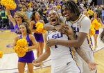 LSU guard Ja'vonte Smart (1) is congratulated by forward Naz Reid (0) after No. 13 LSU defeated No. 5 Tennessee 82-80 in overtime during an NCAA college basketball game in Baton Rouge, La., Saturday, Feb. 23, 2019. (David Grunfeld/The Times-Picayune via AP)