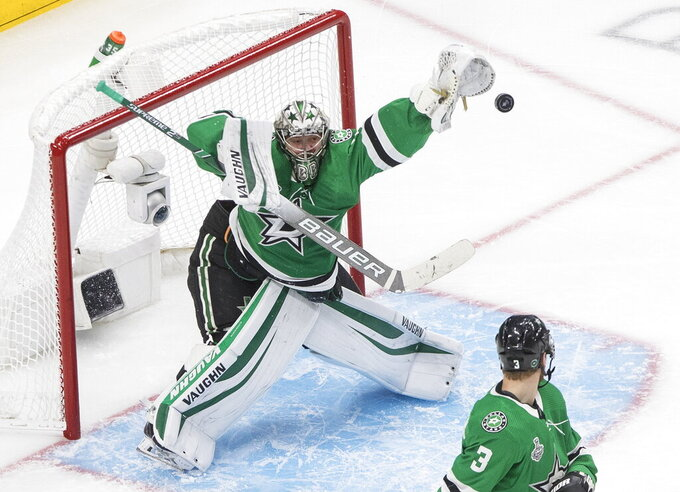 FILE - Dallas Stars goaltender Anton Khudobin (35) makes a save against the Tampa Bay Lightning during the third period of Game 4 of the NHL hockey Stanley Cup Final in Edmonton, Alberta, in this Friday, Sept. 25, 2020, file photo. Khudobin signed a $10 million, three-year contract to stay with the Stars. (Jason Franson/The Canadian Press via AP, File)