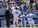 Los Angeles Dodgers starting pitcher Hyun-Jin Ryu (99) is greeted in the dugout by manager Dave Roberts, center, and bench coach Bob Geren at the end of the eighth inning of a baseball game against the Washington Nationals Sunday, May 12, 2019, in Los Angeles. (AP Photo/Marcio Jose Sanchez)