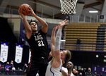 Gonzaga forward Anton Watson, left, drives to the basket as Portland forward Mikey Henn defends during the first half of an NCAA college basketball game in Portland, Ore., Saturday, Jan. 9, 2021. (AP Photo/Steve Dykes)
