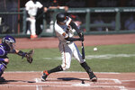 San Francisco Giants' Wilmer Flores hits an RBI single against the Colorado Rockies during the first inning of a baseball game in San Francisco, Thursday, Sept. 24, 2020. (AP Photo/Jed Jacobsohn)