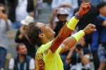 FILE - In this June 9, 2019, file photo, Spain's Rafael Nadal celebrates his record 12th French Open tennis tournament title after winning his men's final match against Austria's Dominic Thiem in four sets, 6-3, 5-7, 6-1, 6-1, at Roland Garros stadium in Paris. (AP Photo/Michel Euler, File)