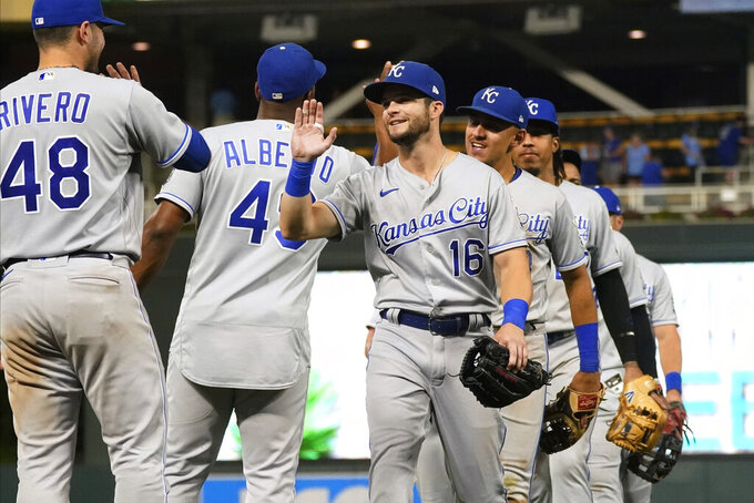 Kansas City Royals' Andrew Benintendi (16) goes through the celebration line after the Royals defeated the Minnesota Twins 6-4 in 11 innings in a baseball game Friday, Sept. 10, 2021, in Minneapolis. Benintendi had a two-run homer in the 11th inning and a three-run homer in the first inning. (AP Photo/Jim Mone)