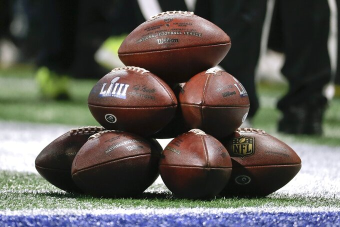 A stack of footballs wait to be used before the NFL Super Bowl 53 football game between the Los Angeles Rams and the New England Patriots Sunday, Feb. 3, 2019, in Atlanta. (AP Photo/Chuck Burton)