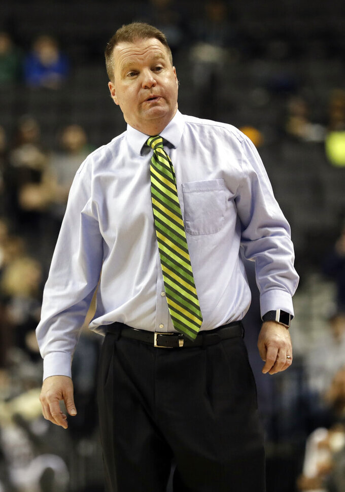 George Mason head coach Dave Paulsen reacts during the first half of an NCAA college basketball game in the Atlantic 10 men's tournament Friday, March 15, 2019, in New York. St. Bonaventure won 68-57. (AP Photo/Frank Franklin II)