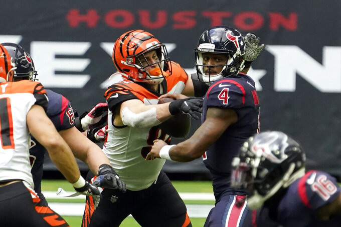 Houston Texans quarterback Deshaun Watson (4) fumbles the football as he is hit by Cincinnati Bengals' Sam Hubbard (94) during the second half of an NFL football game Sunday, Dec. 27, 2020, in Houston. The Bengals recovered the fumble. (AP Photo/Eric Christian Smith)