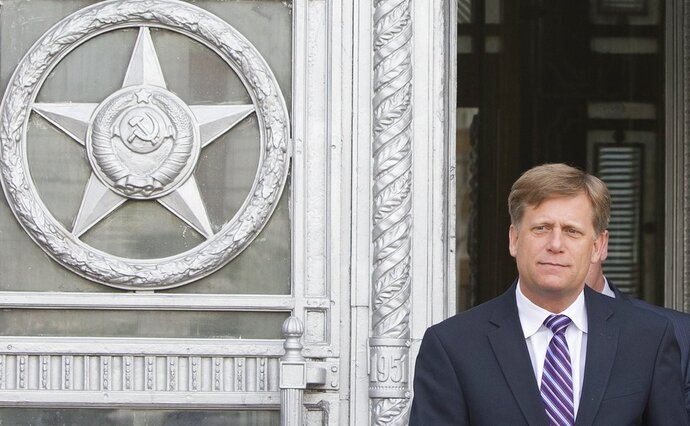 "FILE - In this May 15, 2013 file photo, U.S. Ambassador to Russia Michael McFaul leaves the Foreign Ministry in Moscow, Russia. A memoir by the former U.S. ambassador, whom Russian officials have said they want to interview, is in the top 10 on Amazon.com. McFaul's ""From Cold War to Hot Peace: An American Ambassador in Putin's Russia"" was No. 6 as of midday Thursday. The book was published in May. (AP Photo/Misha Japaridze, File)"