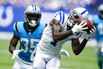 Indianapolis Colts wide receiver Parris Campbell (1) makes a catch in front of Carolina Panthers corner back Troy Pride Jr. (25) during the first half of an NFL exhibition football game in Indianapolis, Sunday, Aug. 15, 2021. (AP Photo/Michael Conroy)