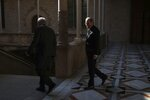 Catalan regional President Quim Torra, right, walks at the Palace of the Generalitat prior to a meeting with Spanish Prime Minister Pedro Sanchez, in Barcelona, Thursday, Feb. 6, 2020. (AP Photo/Emilio Morenatti)