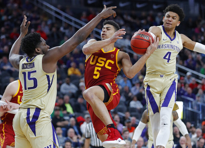 Washington's Matisse Thybulle (4) steals the ball from Southern California's Derryck Thornton, center, beside teammate Noah Dickerson (15) during the second half of an NCAA college basketball game in the quarterfinal round of the Pac-12 men's tournament Thursday, March 14, 2019, in Las Vegas. (AP Photo/John Locher)