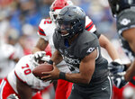 Air Force quarterback Arion Worthman, front, runs for yardage as Stony Brook linebacker Keegan Henderson, center, and defensive lineman Brandon Lopez pursue in the first half of an NCAA college football game Saturday, Sept. 1, 2018, at Air Force Academy, Colo. (AP Photo/David Zalubowski)