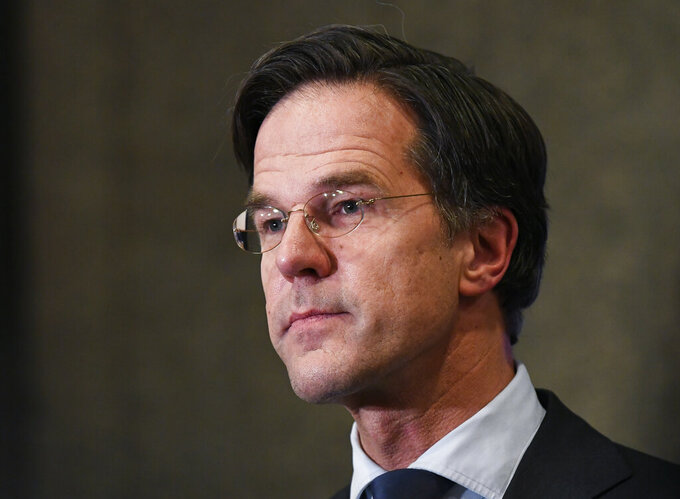 Dutch caretaker Prime Minister Mark Rutte speaks with the media following exit polls in the general election in The Hague, Netherlands, March 17, 2021. Dutch voters pushed Rutte towards a fourth term in office in a general election Wednesday, bolstering his conservative party's position as the biggest in parliament and boosting a key ally into second place, an exit poll suggested. (Piroschka van de Wouw/Pool via AP)