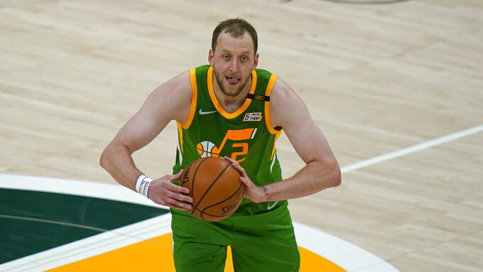 """FILE - Utah Jazz guard Joe Ingles (2) brings the ball up court in the first half during an NBA basketball game against the Minnesota Timberwolves in Salt Lake City, in this Saturday, April 24, 2021, file photo. Ingles will play for Australia at the Tokyo Games. """"There's a goal of trying to win a gold medal for Australia, which we've never done — or trying to win a medal, which we've never done,"""" Australia guard Joe Ingles of the Jazz said. """"That's something that's been a goal of mine since I made the Beijing Olympics in 2008 and we haven't been able to do it.""""(AP Photo/Rick Bowmer, File)"""