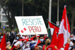 """A supporter of presidential candidate Keiko Fujimori holds up a sign that reads in Spanish: """"Resist Peru"""" during a protest against alleged election fraud, in Lima, Peru, Saturday, June 12, 2021.  Supporters are hoping to reverse the results of the June 6th presidential runoff election that seem to have given the win to opponent Pedro Castillo amid unproven claims of possible vote tampering. (AP Photo/Guadalupe Pardo)"""